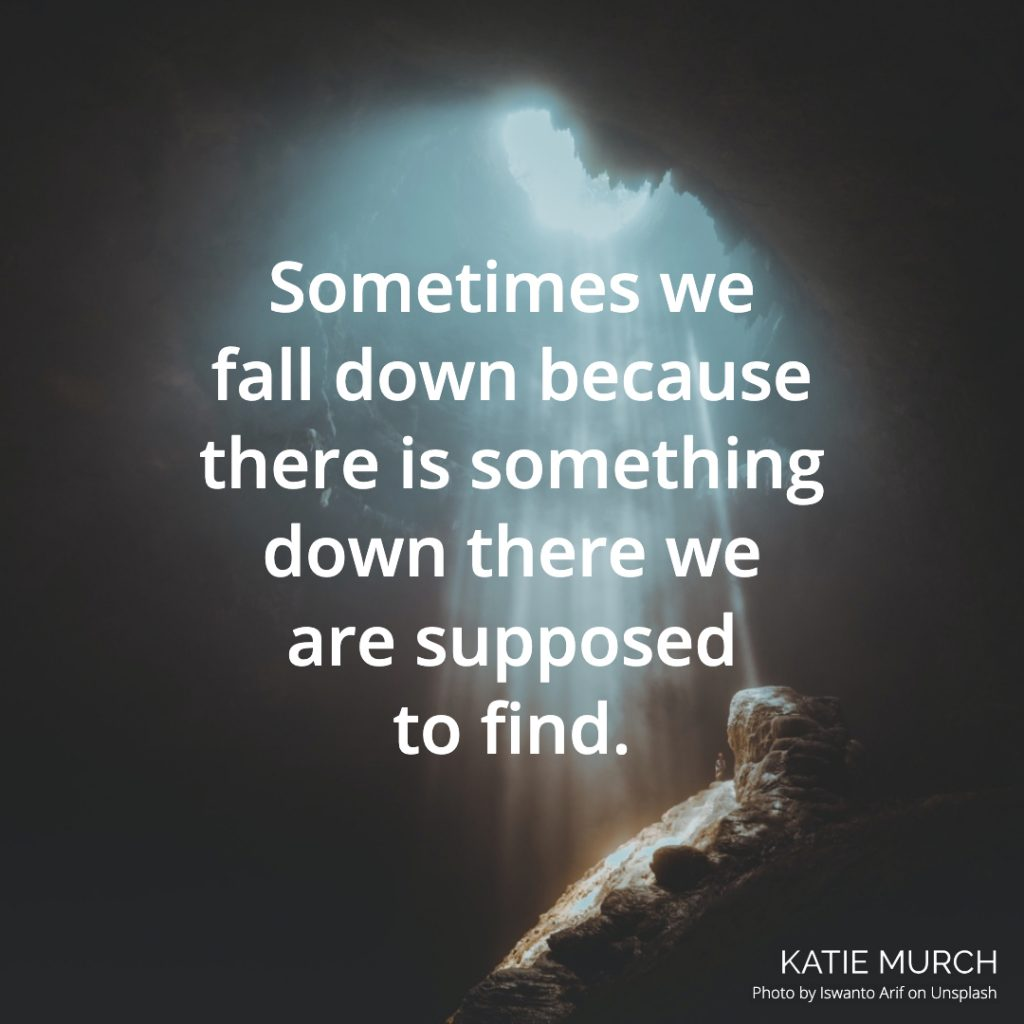 Quote is in front a dark cave with light shining down through an opening above. Katie Murch and photo credit is on the bottom right of the image.