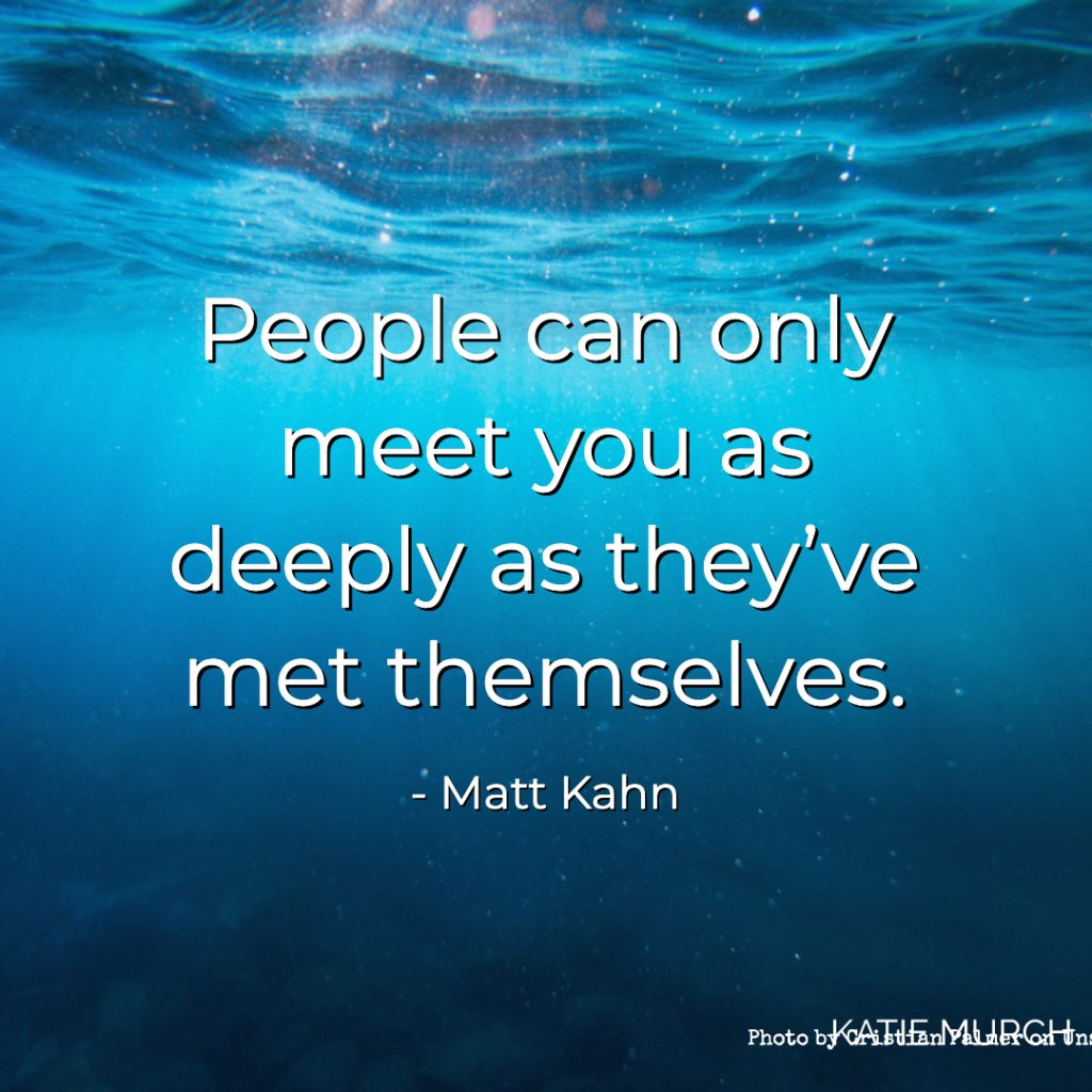 Quote is in front of an underwater shot of a deep blue ocean with nothing else in sight. Katie Murch and photo credit is on the bottom right of the image.