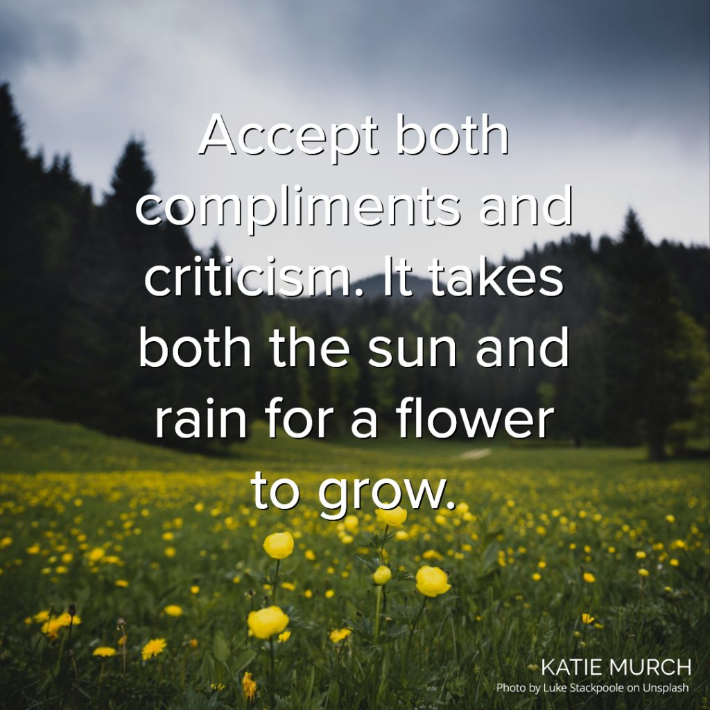 Quote is in front of a green field with yellow flowers in the front and pine trees in the back. A gray sky is above. Katie Murch and photo credit is on the bottom right of the image.