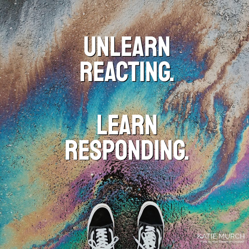 Quote is in front of the asphalt covered with oil reflecting various colors. A pair of black vans shoes can be seen on the bottom. Katie Murch and photo credit is on the bottom right of the image.