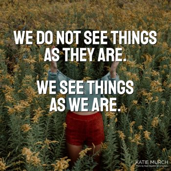 Quote is in front of a field of wildflowers. A light-skinned person is wearing red flower shorts and a blue long sleeve crop top. This person is holding a mirror that reflects the wildflower while covering her face. Katie Murch and photo credit is on the bottom right of the image.
